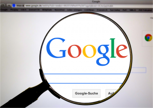 Magnifying Glass Showing Google Search Bar