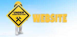 image of man holding under construction sign for a website