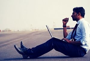 Man With Laptop Sitting Thinking