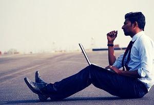 Man With Laptop Sitting Thinking