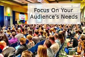 An audience with the words focus on your audience's needs