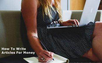 Woman sitting with computer on lap writing on a writing pad