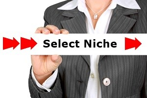 Woman holding a sign with the words Select Niche