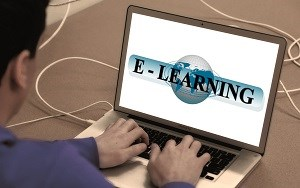 Man looking at computer screen e learning