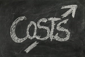 Blackboard with the word costs and an arrow going through the word