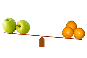 a see-saw with apples and oranges balanced at each end