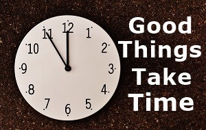 Good things take time next to a clock face