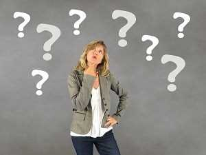 Woman thinking and wondering with question marks all around her