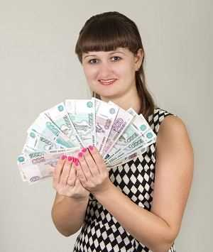 Woman holding banknotes spread out in her hands