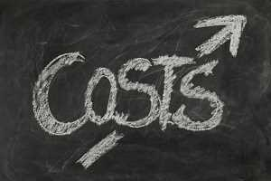 Blackboard with the words costs